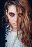 Close-up portrait of the sad beautiful grunge rock girl Royalty Free Stock Images