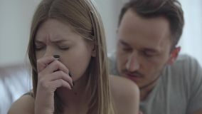 Close-up portrait of sad broken woman and her husband asking for forgiveness. Problems in the relationship between man. Close up portrait of a sad broken woman stock footage
