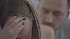 Close up portrait of sad broken woman and her husband asking for forgiveness. Problems in the relationship between man. Close up portrait of a sad broken woman stock video footage