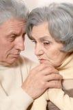 Close-up portrait of sad elder couple on a black background. Iso Royalty Free Stock Photo