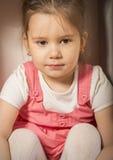 Close up portrait of sad little girl. Expressive little girl, melancholic, thinking away, studio shot on brown background Stock Images