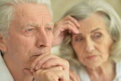 Close up portrait of sad senior couple at home. Sad senior couple posing on background at home stock photography