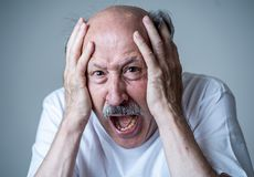 Close up of scared and shocked senior man gesturing in fear with hands and face. Close up portrait of a scared frightened old man in expression of fear in human stock photos