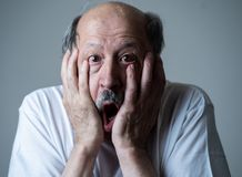 Close up of scared and shocked senior man gesturing in fear with hands and face. Close up portrait of a scared frightened old man in expression of fear in human stock image