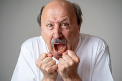 Close up of scared and shocked senior man gesturing in fear with hands and face. Close up portrait of a scared frightened old man in expression of fear in human stock images