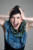 Close up portrait of screaming young short hair girl expression Royalty Free Stock Photos