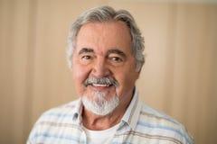 Close-up portrait of senior man against wall stock photos