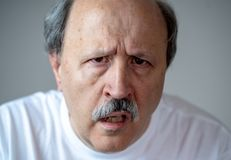 Portrait of disorientated and confused old man suffering from Alzheimer. Close up portrait of senior man looking confused and lost suffering from dementia royalty free stock photos
