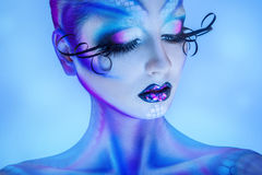 Close up portrait of sensual woman with healthy skin and creative body art stock photo
