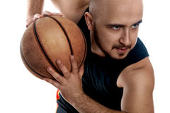 Close up portrait of serious basketball player on white backgrou Royalty Free Stock Image