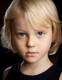 Close-up portrait of serious boy. Royalty Free Stock Image