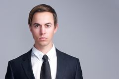 Close up portrait of a serious business man face Stock Photo