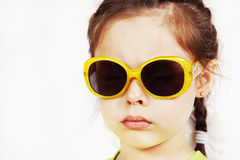 Close up portrait of a serious cute little girl Stock Photo