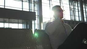 Close up portrait of serious handsome business man in sunglasses speaking on cellphone at the office. Young businessman stock video footage