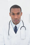 Close up portrait of a serious male doctor Stock Photography