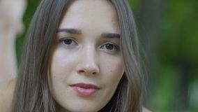 Close-up portrait serious woman looking in camera, crisis female problems slow stock video