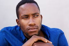 Serious young african man looking away and thinking Stock Photography