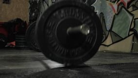 Close up portrait of a serious young man athlete standing and holding barbell in crossfit center. Close up portrait of a serious young man athlete standing and stock video