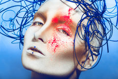 Close up portrait of sexual woman with body art and neon powder Royalty Free Stock Photography
