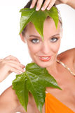 Close up portrait of a sexy blonde woman with leaf Royalty Free Stock Images