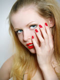 Close-up portrait of sexy caucasian young woman. With golden glamour make-up and red bright manicure Stock Photography