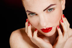 Close-up portrait of european young woman model with glamour make-up and red bright manicure. christmas makeup, bloody red li Royalty Free Stock Images