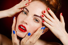 Close-up portrait of european young woman model with glamour make-up and red bright manicure. christmas makeup, bloody red li Royalty Free Stock Photography