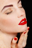 Close-up portrait of sexy european young woman model with glamour make-up and red bright manicure. christmas makeup, bloody red li Royalty Free Stock Images