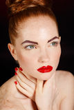 Close-up portrait of sexy european young woman model with glamour make-up and red bright manicure. christmas makeup, bloody red li Stock Photo
