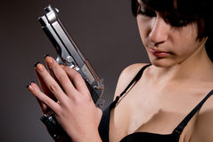 Close-up portrait of sexy woman with gun Royalty Free Stock Image
