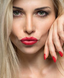 Close-up portrait of sexy woman lips with red lipstick and red m Royalty Free Stock Photo