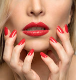Close-up portrait of sexy woman lips with red lipstick and red m Stock Image