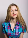 Close-up portrait of sexy young girl in jeans and a plaid shirt.  Stock Photography