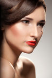 Red lips. Portrait of a Beautiful Woman. Makeup Royalty Free Stock Photo