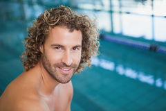 Close up portrait of a shirtless fit swimmer by pool Stock Image