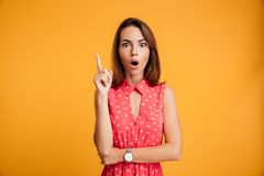Close-up portrait of shocked charming young woman in red dress p Stock Image