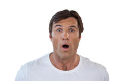 Close-up portrait of shocked mature man with mouth open. Against white background Royalty Free Stock Images