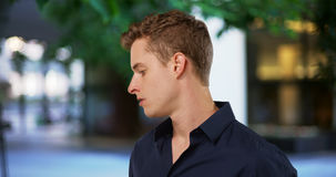 Close-up portrait of single white man looking down serious Royalty Free Stock Photography