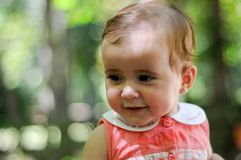 Six months old baby girl smiling outdoors. Royalty Free Stock Photos