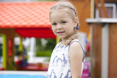 Close up portrait of a six year little girl, against background royalty free stock image