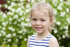 Close up portrait of a six year little girl, against background stock photo