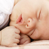 Close-up portrait of a sleeping baby on white Royalty Free Stock Images