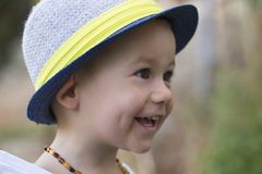 Portrait of a small sweet smiling boy with a hat Stock Image