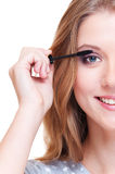 Close up portrait of smiley woman doing make up Stock Images