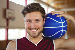 Close up portrait of smiling basketball player holding ball Stock Images