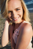 Close up portrait of smiling blond at beach Stock Photo