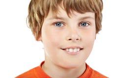 Close-up portrait of smiling boy. In orange T-shirt Stock Image