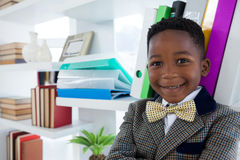 Close up portrait of smiling boy imitating as businessman Royalty Free Stock Photography