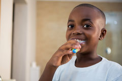 Close-up portrait of smiling boy with toothbrush. At domestic bathroom Stock Photos