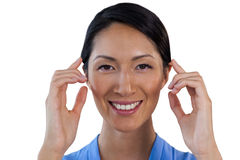 Close up portrait of smiling businesswoman adjusting invisible eyeglasses. Against white background stock photography